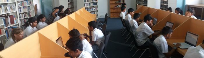 Form 3 Class undertaking a Humanities research task in the Library